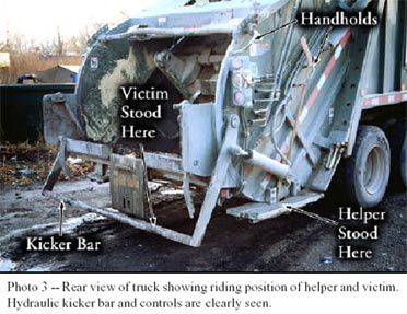 Photo 3 - Rear view of truck showing riding position of helper and victim.  Hydraulic kicker bar and controls are clearly seen.