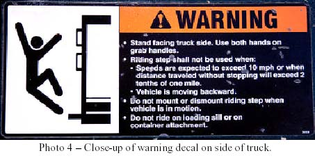 Photo 4 - Close-up of warning decal on side of truck.