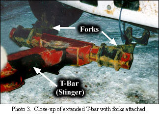close-up of extended T-bar with forks attached.