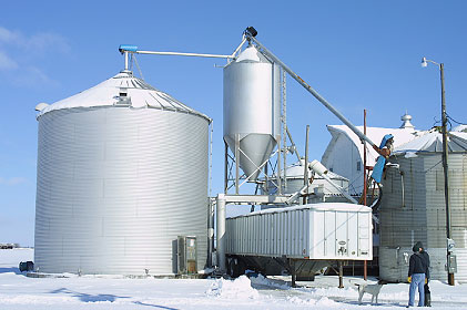 Photo 1 -- View of large grain bin and grain handling equipment at the farm