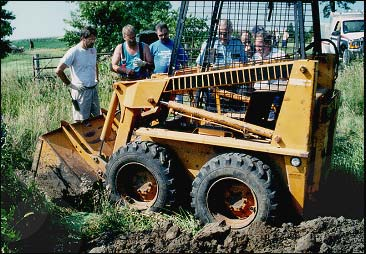Side view of skid-steer loader after the incident