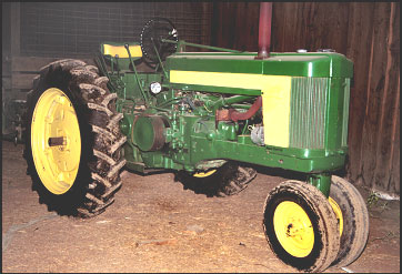 side view of identical tractor model