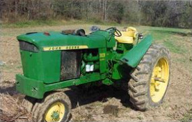 Figure 1.  Tractor that overturned showing fender on which victim had been sitting.