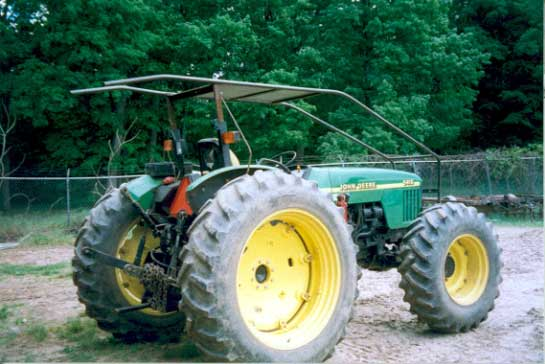 Figure 3 - The tractor involved in the incident with the top section of the ROPS disconnected and the wire guard installed.