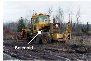 Photo of the grader with arrow pointing to solenoid
