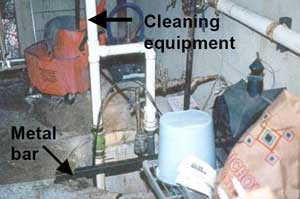 Photo of incident site showing cleaning equipment and metal bar.