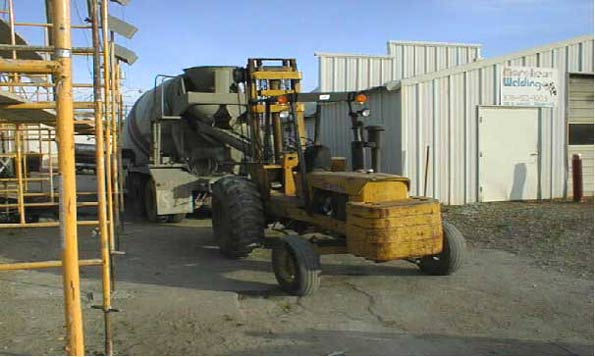 Picture #7: Forklift and cement truck taken shortly after accident.