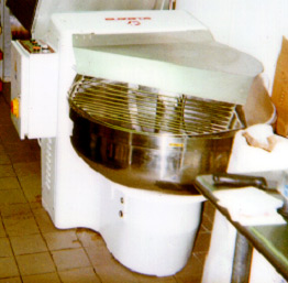 photo of dough mixing machine with cover lowered