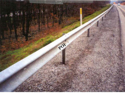 Guardrail on South Shoulder of Westbound Lane. Guardrail is marked POI to designate the apparent point of impact with victim.