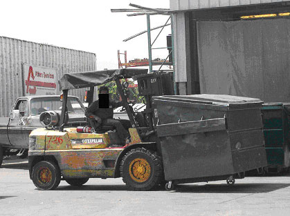 Exhibit 1. Picture of a forklift transporting a trash        bin similar to the one involved in this incident.
