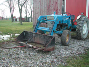 Figure 8. Bale spear attachment to loader bucket