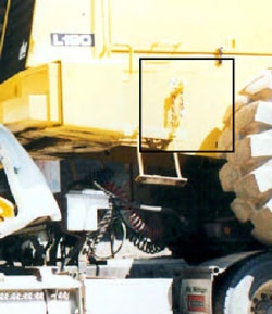 Figure 12. Chain located on loader, driver's side
