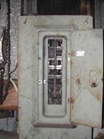 Figure 7. Unlabeled circuit breaker box in shed