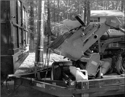 Photo 1: Police photo of backhoe, truck, and trailer