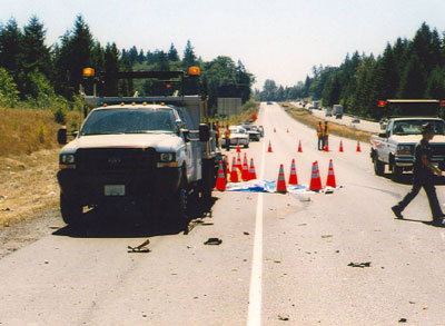 incident scene after emergency response, facing west, looking up the hill toward on-coming traffic