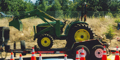 the tractor and mower attachment