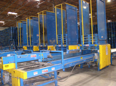 Exhibit #1. View of the pallet stackers from the front or loading end.