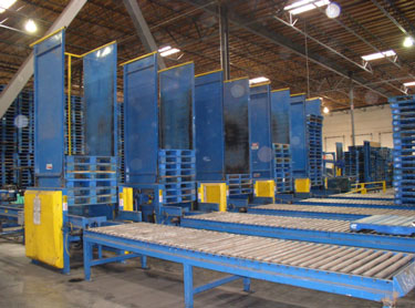 Exhibit #2. View of the pallet stackers from the rear or unloading end.