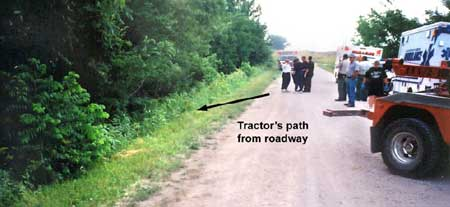 Photo 3 - Incident scene facing east, showing road conditions and path the tractor traveled into the ditch.