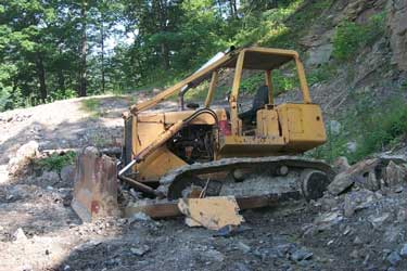 Picture of bulldozer in the mountainside after incident occurred.