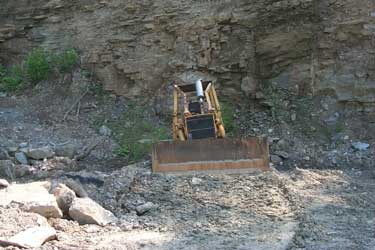 Bulldozer in the side of the mountain.