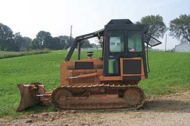 A picture of the bulldozer after it had been partially cleaned up and repaired.
