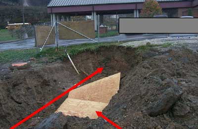 Location of victim in trench when sides collapsed. Plywood used by emergency response personnel.