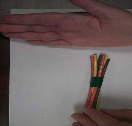 An example of wires lead electrician was taping in his palm when he was electrocuted.