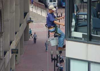 Figure 3. Window washer using rope descent system with a seat board