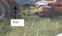 Figure 2. Rope attached to pin for flail mower