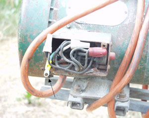 Picture #7: Portable auger motor housing opened with new ground wire.