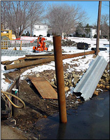 Photo 2. Piles: steel pipe pile in water, sheet pile to right