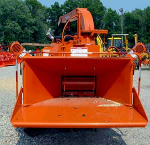 Photo 3. New chipper showing feed wheels, hopper feed table, and emergency stop pull cords in hopper.