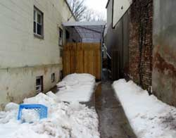 Photo 1. Driveway between two buildings. Incident occurred behind the new fence.