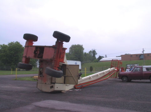 Figure 2. The aerial work platform tipped over during the incident and hit a pickup truck that was parked near by.