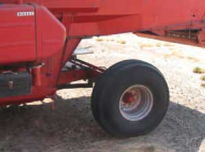 Photo 2. Space between rear tires and combine body and short narrow deflection shield.