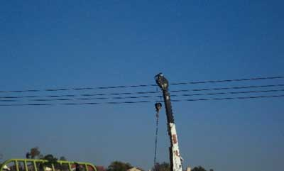 Exhibit #2. A picture of the incident scene with the crane boom still in contact with the high voltage
