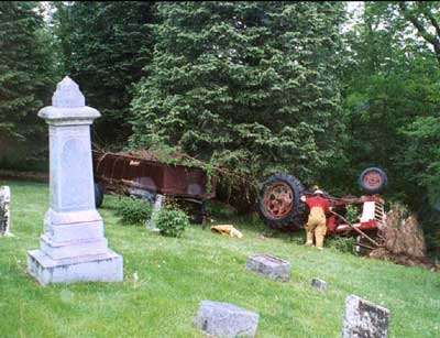 overturned tractor in cemetery