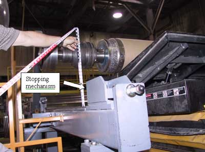 Figure 3. During the incident, the steel spool was above the stopping mechanism on the tracks and only held by the tilter.