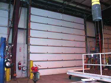 Photo 1. The overhead door that was involved in the fatal incident: a standard lift steel insulated door with six-inch lift drums.