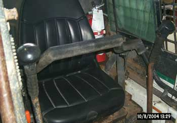 Figure 3. Skid-steer loader operator's seat and lap bar.