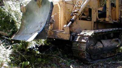 The final resting position of the bulldozer shows the front blade was raised about 1 ft off the ground when parked.