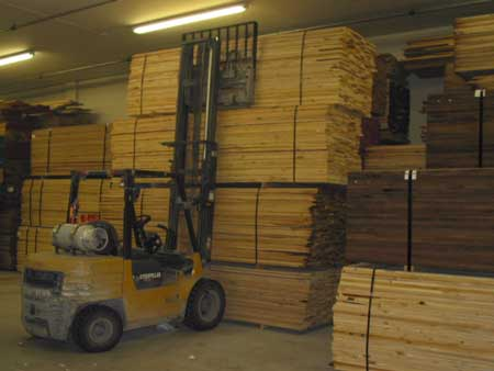 Figure 1. The forklift stacking the fourth bundle of lumber.