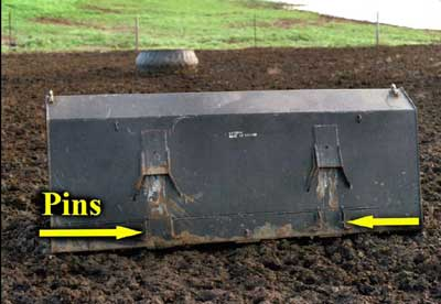 location of horizontal pins on loader bucket