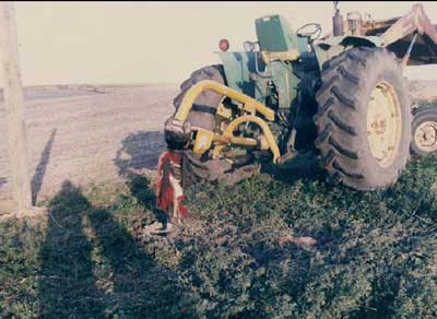 Tractor with posthole digger attachment