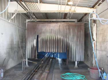 Exhibit 2. The car wash tunnel looking from the tunnel entrance.