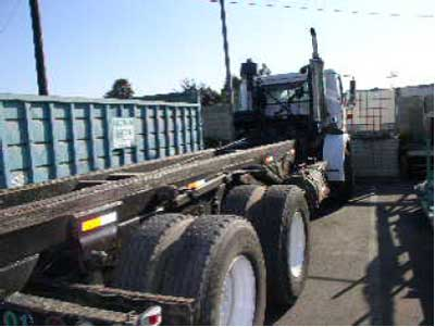 Exhibit 1: A picture of a roll-off truck similar to the one involved in the incident.