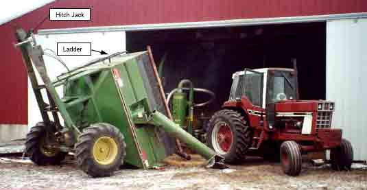 tractor, grain vacuum, and the tipped grain cart