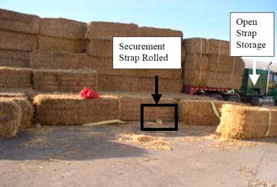 Straps on bales on gooseneck, rolled securement strap, open strap storage on cab