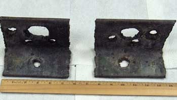 "IAttachment 4. Job-site manufactured lifting devices that were on top of concrete ""cap"" piece."